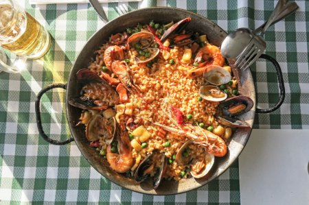 seafood paella in traditional pan