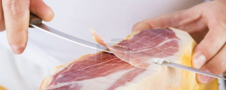 Professional cutting of serrano ham