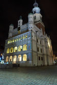 Facade of the Renaissance town hall at night in Poznan