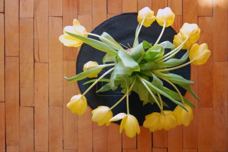 Yellow tulips in lace vase