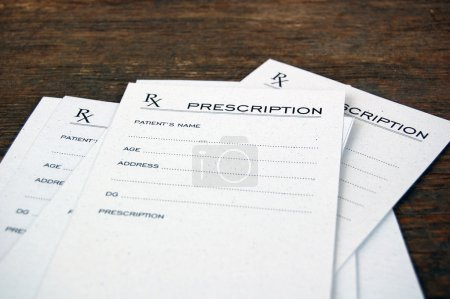 Blank prescriptions over wooden table