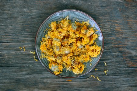 Dried marigold on wooden table