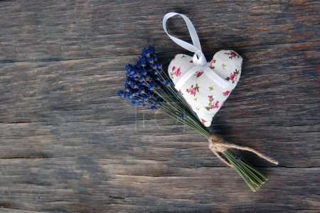 Lavender flowers and lavender bag on table