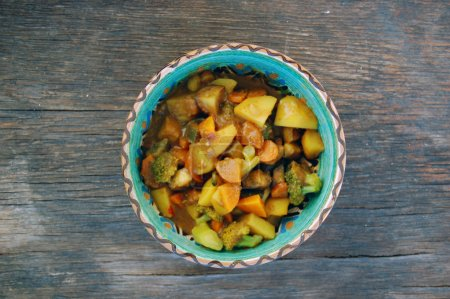 Photo for Closeup of Indian meal. fresh seasonal vegetables with curry sauce - Royalty Free Image