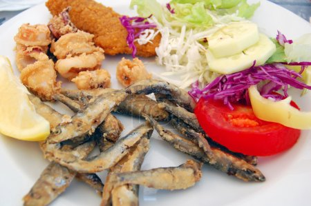 deep fried seafood with fresh salad