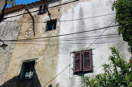 Detail of old building's facade with windows