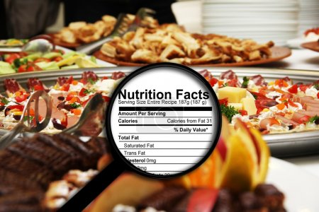 Photo for Magnifying glass on nutrition facts - Royalty Free Image