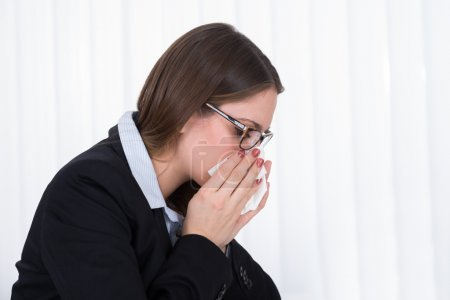 Businesswoman Blowing Nose