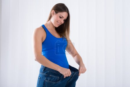 Woman Showing Weightless By Jeans
