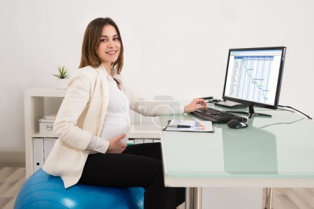 Pregnant Businesswoman  In Office