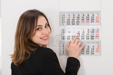 Businesswoman with Calendar Date