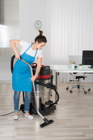 Janitor With Vacuum Cleaner