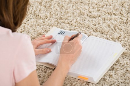 Woman Writing Schedule