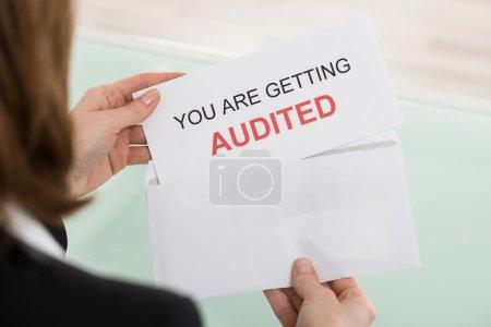 Businesswoman Opening Audit Letter