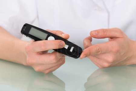 Patient Checking Blood Sugar Level