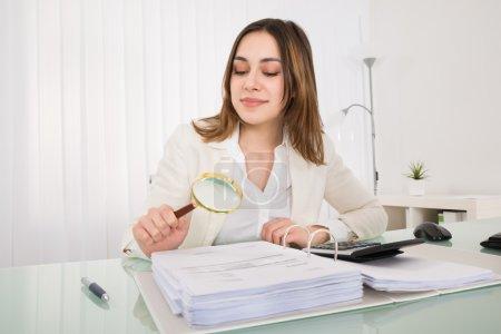 Businesswoman Checking Bill