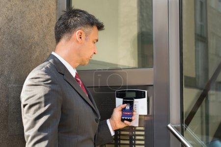 Mature Caucasian Businessman Holding Smartphone Fo...