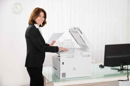 Businesswoman Copying Paper