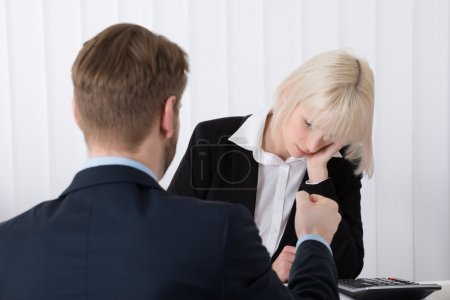 Boss Blaming Female Employee