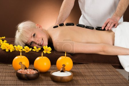 Young Woman Receiving Hot Stone Therapy