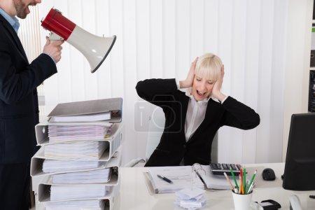 Boss Shouting At Businesswoman