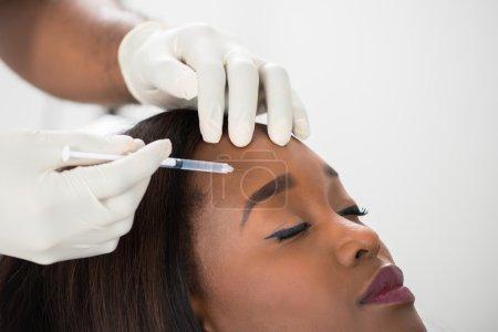 Woman Having Cosmetic Treatment