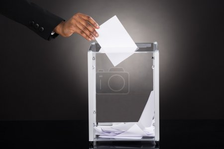 Businessperson Inserting Ballot In Box