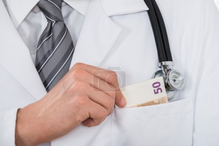 Doctor Putting Money In Pocket
