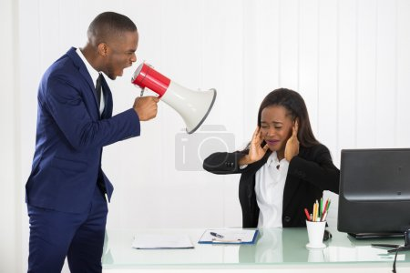 Boss Shouting At Young Businesswoman