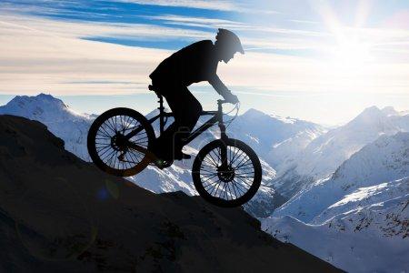 Man Cycling On Mountain