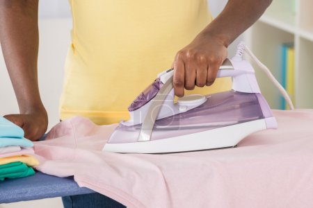 Female Hands Ironing Clothes