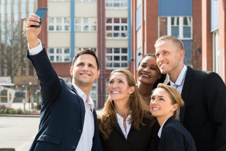 Businesspeople Taking Selfie With Mobile Phone