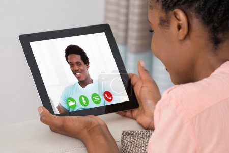 Young Woman Video Conferencing With Man