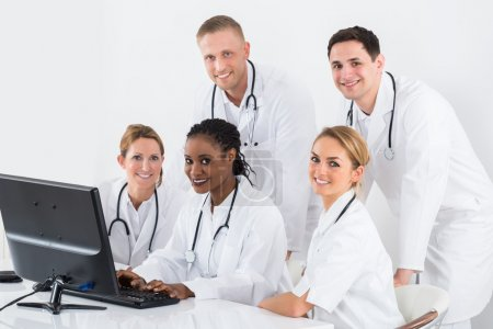 Group Of Doctors Looking At Computer