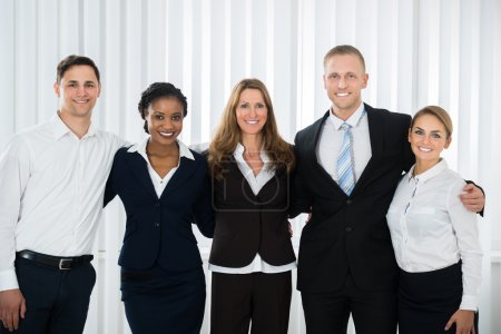 Photo for Group Of Happy Businesspeople Standing In Office - Royalty Free Image