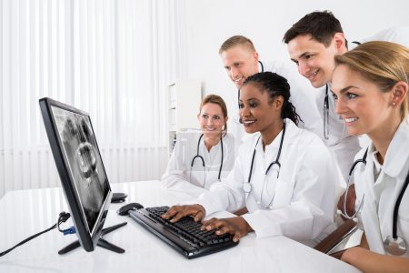 Doctors Looking At X-ray On Computer