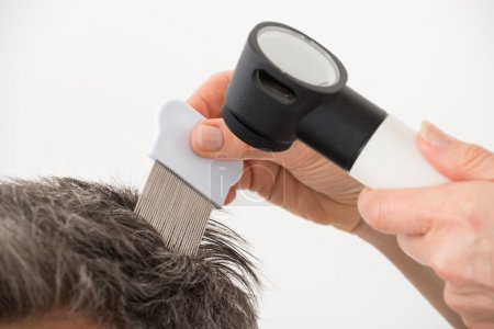 Doctor Examining Patient's Hair