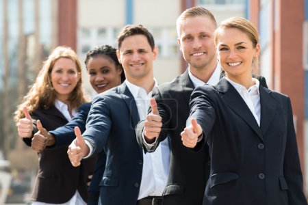 Businesspeople Showing Thumb Up Sign