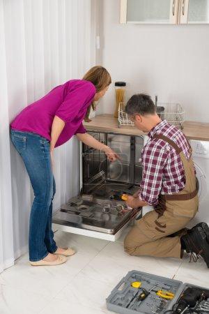Repairman Checking Dishwasher