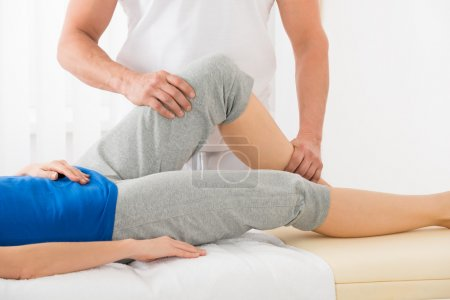 Therapist Doing Knee Massage