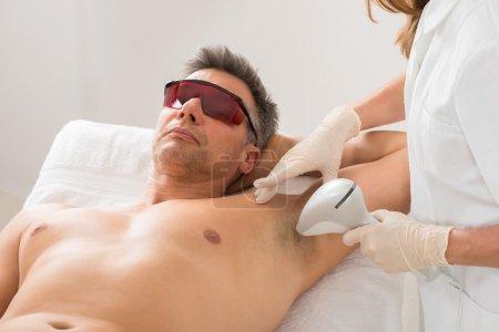 man Receiving Laser Hair Removal