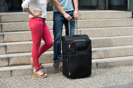 Couple Standing With Luggage