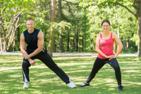 Athletic Couple Doing Exercise