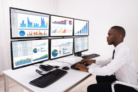 Businessman Analyzing Financial Chart On Computer