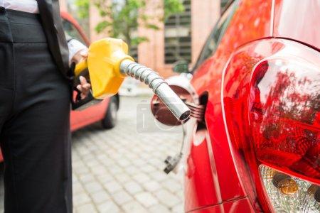 Businesswoman Hand Refueling Car's Tank