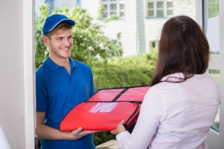 Man Delivering Pizza To Young Woman