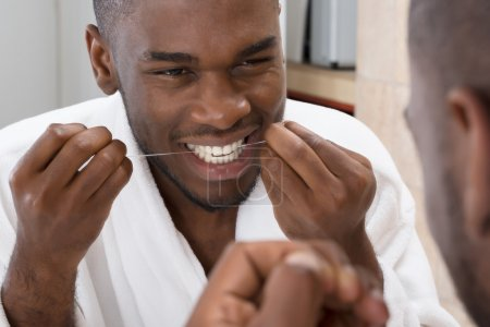 African Man Cleaning His Teeth