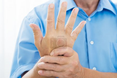 Person's Hand With Pain On The Wrist