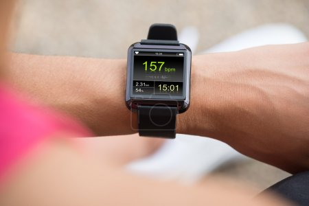 Human Hand Wearing Smart Watch Showing Heartbeat Rate