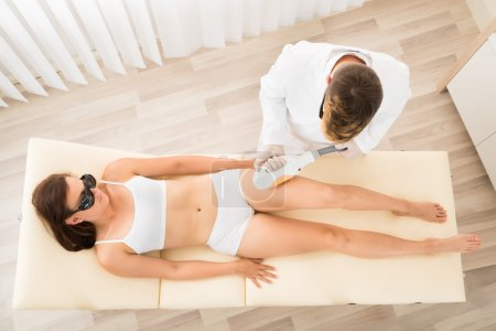 Male Therapist Giving Laser Epilation Treatment